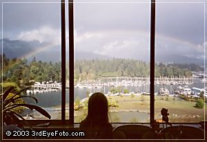 Kaelin looking out at a rainbow